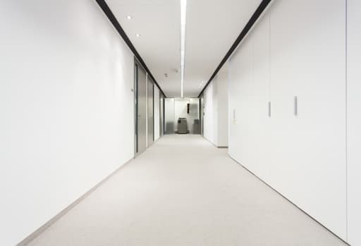 A picture of a white office hallway after fresh commercial painting.
